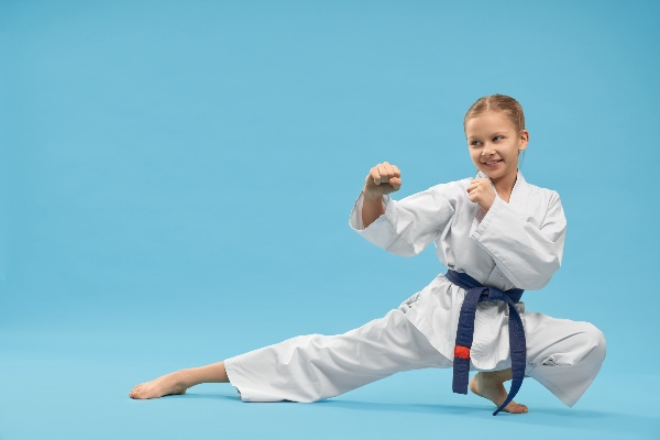 A child practicing martial arts will experience many physical and mental health benefits.